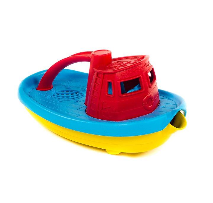 Leksaksbåt som är en vattenkanna